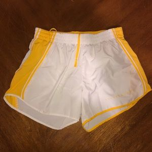 NIKE yellow and white LIVE STRONG athletic shorts